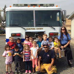 Children in front of a fire truck