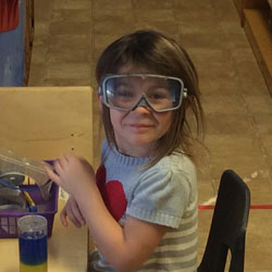A child wearing safety glasses