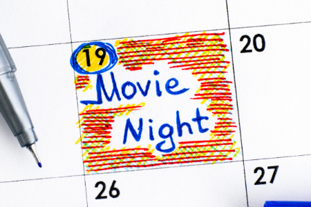 "Picture of calendar that has the words ""Movie Night"" highlighted on one day"