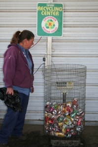Recycling attendant weighs aluminum cans at the recycling center.3.JPG