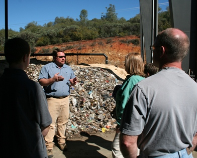 Calvin Jones gives tour of landfill.JPG