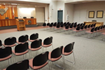 Photograph of Mariposa County Government Center with chairs facing the dais